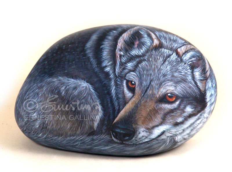 wolf hand painted on stone